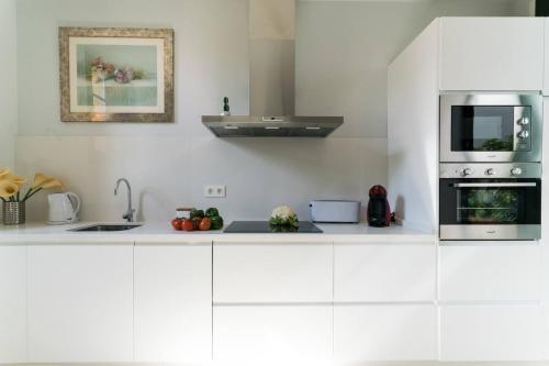 A kitchen or kitchenette at Apartamento Casa la Moneda, Catedral