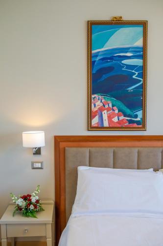 Кровать или кровати в номере Hotel Lidò