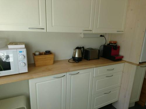 A kitchen or kitchenette at Vuoksi Apartment