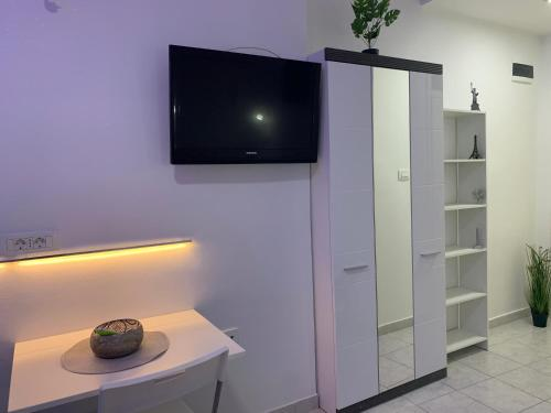 A television and/or entertainment center at Bačvice beach apartment