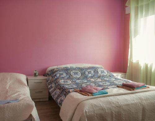A bed or beds in a room at Haava Apartment
