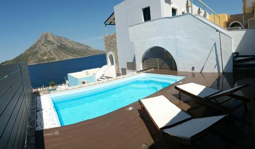 The swimming pool at or near Elena Village