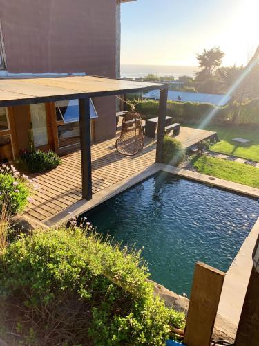 The swimming pool at or near Natural Surf Lodge en Punta de Lobos