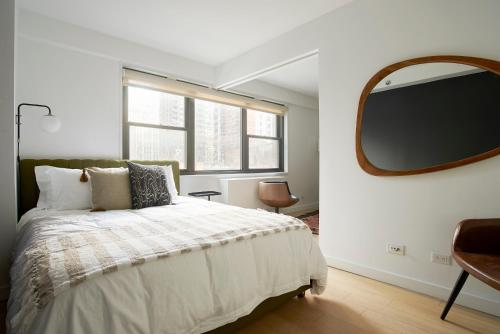 A bed or beds in a room at Sonder — The Nash