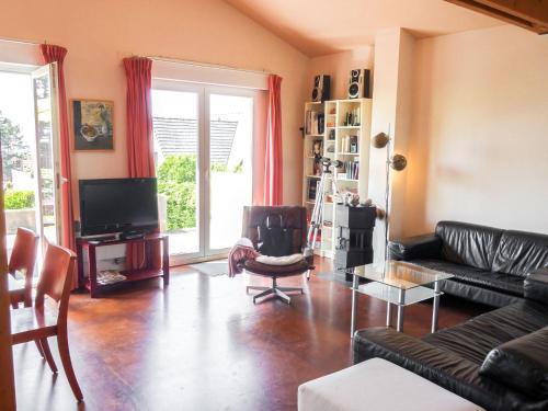 Coin salon dans l'établissement Holiday Home La Marie-Laure