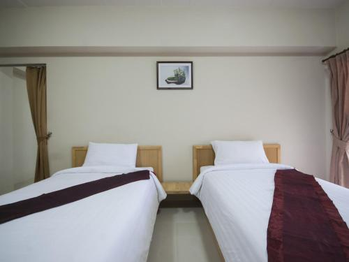 Cama o camas de una habitación en P-Park Residence - Charansanitwong-Rama7