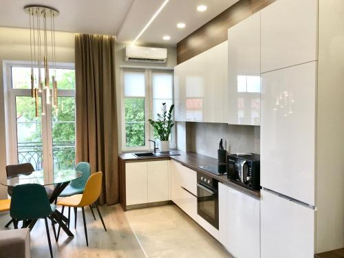 A kitchen or kitchenette at Brestskiy Arbat