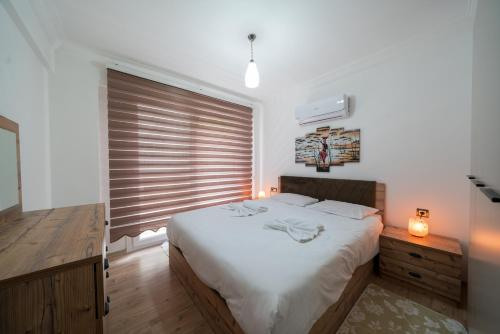 A bed or beds in a room at Lykia Lettings