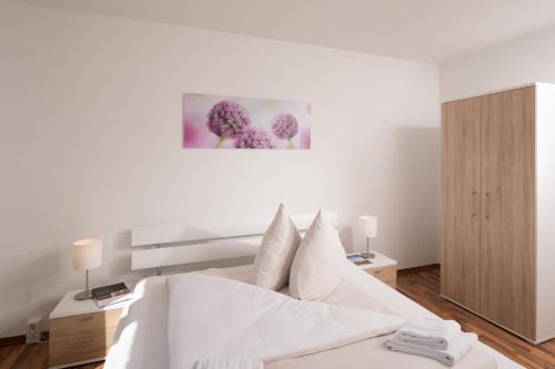 Ein Bett oder Betten in einem Zimmer der Unterkunft Apartments am Brandenburger Tor