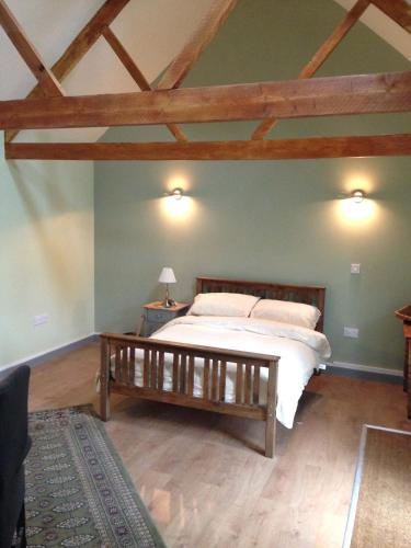 A bed or beds in a room at The Potting Shed