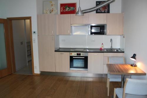 Dapur atau dapur kecil di Bastabraka Apartments