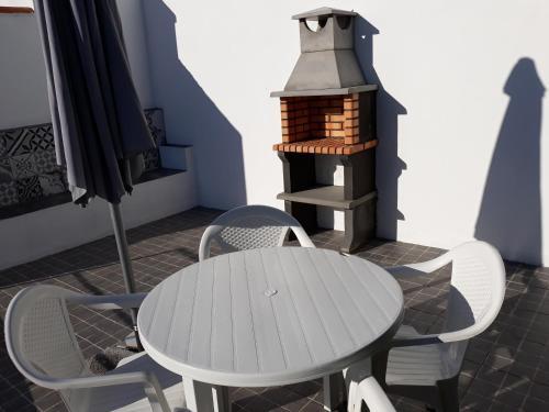 A balcony or terrace at SHR Houses Algarvia