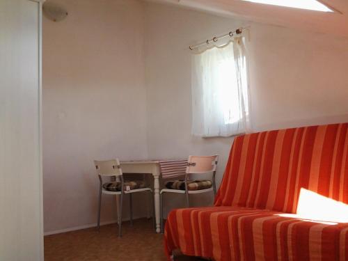Гостиная зона в Apartments Luana