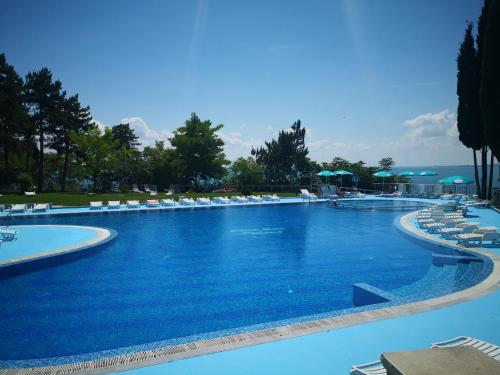 The swimming pool at or near Blue Bay Palace Apart Complex