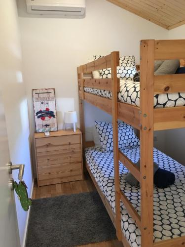 A bunk bed or bunk beds in a room at Casa do Penedo