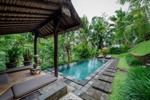 The swimming pool at or near The Desa Ubud