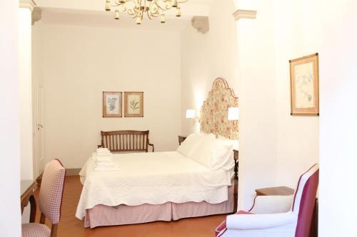 Uma cama ou camas num quarto em BorgoDeiGreci Apartments