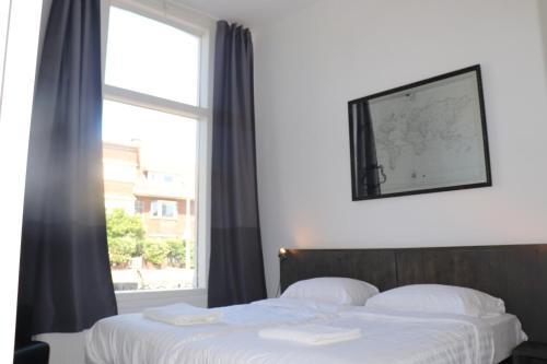 Letto o letti in una camera di Jordans Residence