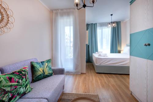 A bed or beds in a room at Aparthotel Dawn Park