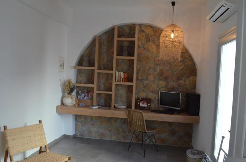A television and/or entertainment center at Makris Beach Hotel