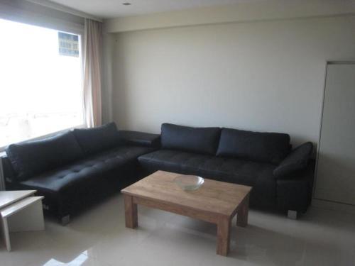 Ein Sitzbereich in der Unterkunft Golden Trust Apartments