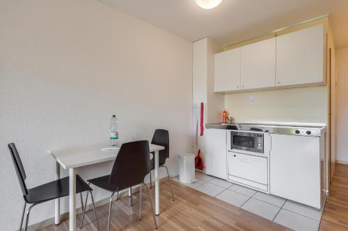 A kitchen or kitchenette at Anstatthotel.ch Hochdorf