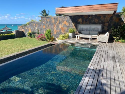The swimming pool at or near Coral Villa