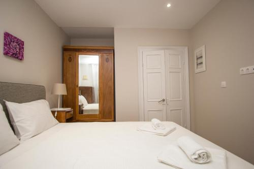 Кровать или кровати в номере St.Spyridon Suites