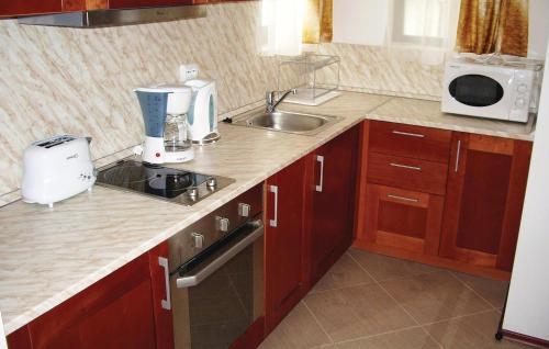 A kitchen or kitchenette at Apartment Kosharitsa Village Bay View Villas III