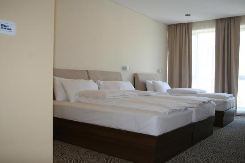 A bed or beds in a room at Hotel Franca