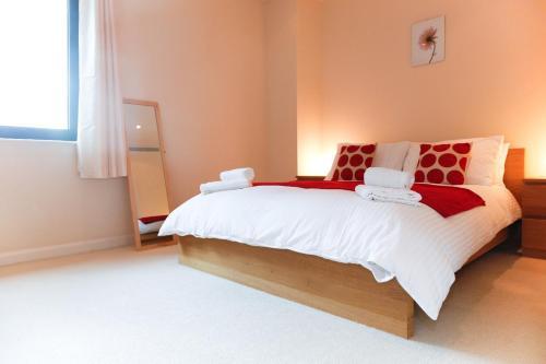 Lova arba lovos apgyvendinimo įstaigoje Horizon Canary Wharf Apartments