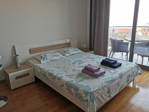 Krevet ili kreveti u jedinici u objektu Apartments Four Seasons