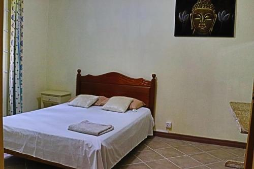 A bed or beds in a room at Ilot Residence
