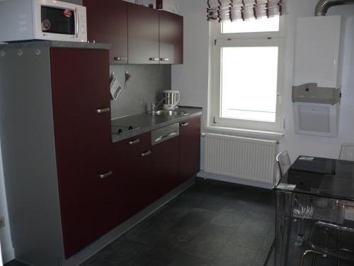 A kitchen or kitchenette at Ferienwohnung Speyer
