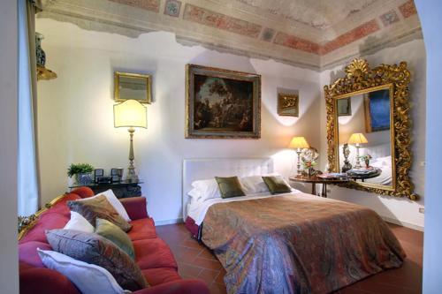 A bed or beds in a room at Terrazza De Medici