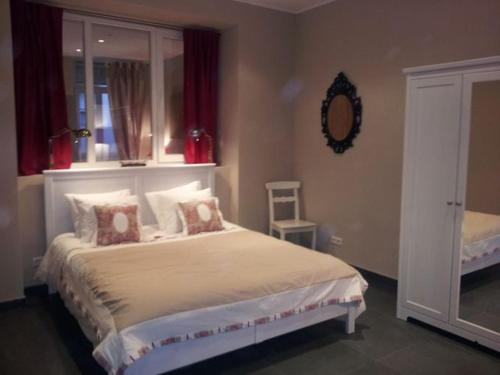A bed or beds in a room at The Guest House II