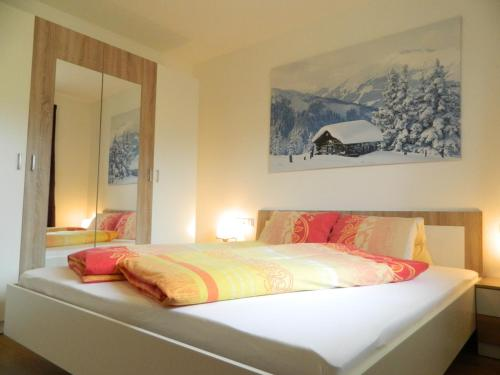 A bed or beds in a room at Haus 4 Holidays