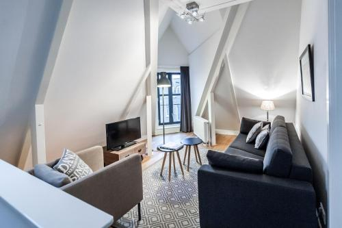 Ein Sitzbereich in der Unterkunft De Pijp Boutique Apartments