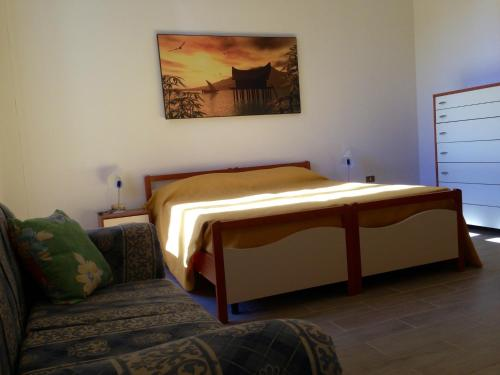 A bed or beds in a room at Casa Ombry Gallipoli