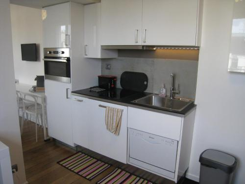 A kitchen or kitchenette at At Home in Paris