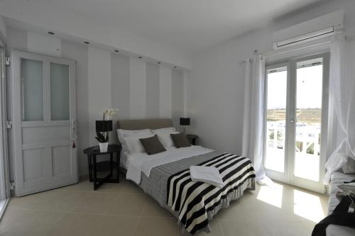 A bed or beds in a room at Romantica Suites