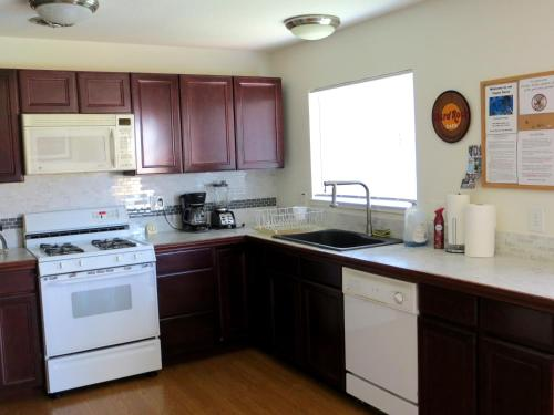 A kitchen or kitchenette at Vegas Oasis