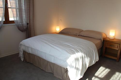 Un ou plusieurs lits dans un hébergement de l'établissement Appartement Roman