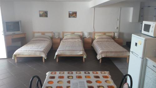A bed or beds in a room at Turista és Munkás Szálló Budapest