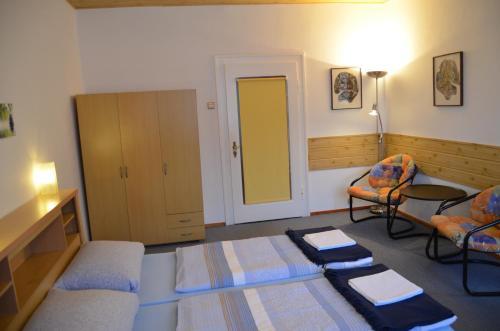 A bed or beds in a room at Ubytování v soukromí Rázlovi