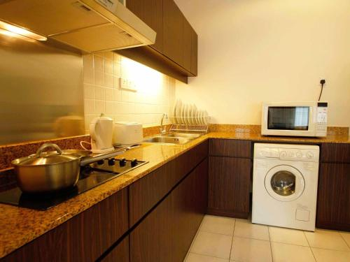 A kitchen or kitchenette at A BEST Seri Bukit Ceylon Serviced Residence