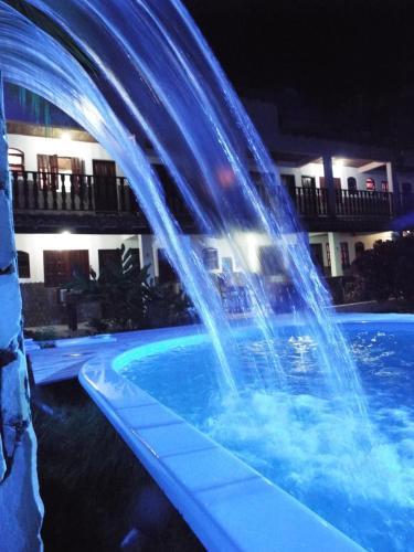 The swimming pool at or near Pousada Alfa
