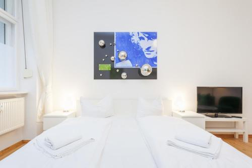A bed or beds in a room at Apartment Berlin Zentrum