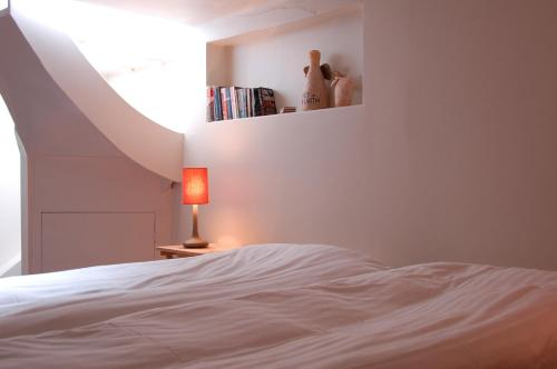 A bed or beds in a room at V27 Apartment