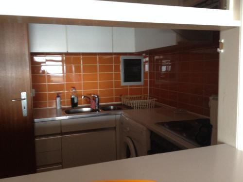 Een keuken of kitchenette bij Apartment Nord Vrie 8D